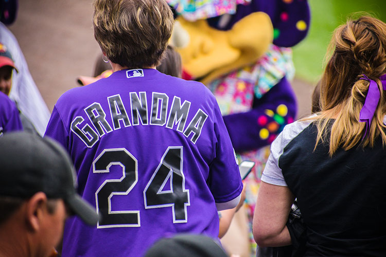 grandma watching a baseball game without worry because of Equita Financial Network